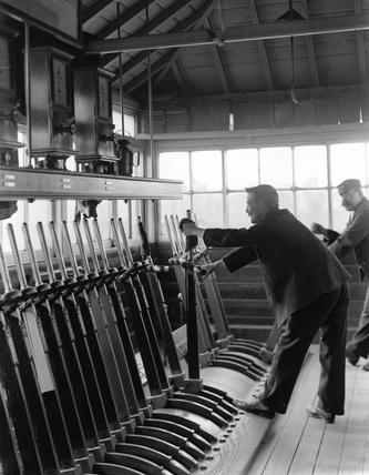 Signalman at work in the signal box at Harrow, London & North Western Railway, 1906.