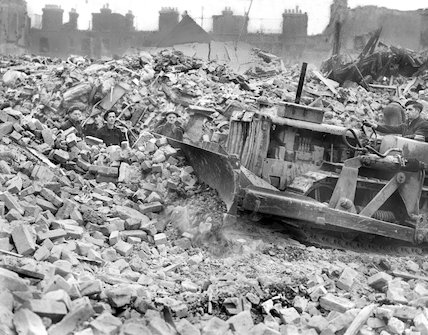 Bulldozer at work clearing rubble at Folkestone Gardens, Deptford. - March-1945