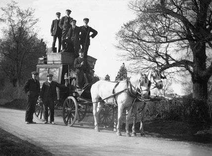 Group of men posing with a horse-drawn carriage, c.1930s.