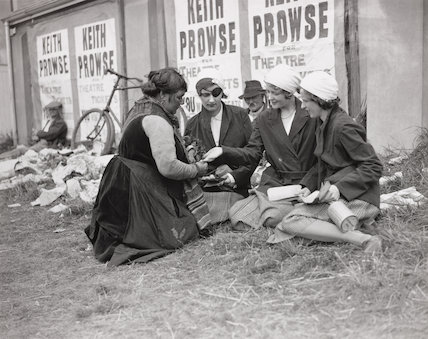 Three girls having their fortune read by a Gypsy woman, Epsom, Surrey, 5 June 1931.