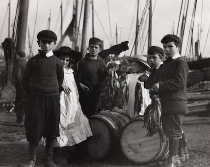 Fisherfolk children posing for camera. Fisherfolk children posing for camera with fish, c 1910s.