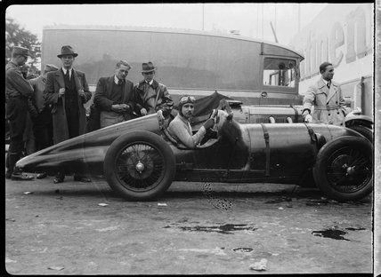 A racing driver at wheel of an Amilcar C6 racing car, Berlin