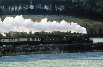 The 'Flying Scotsman' steam locomotive pulling a passenger train.
