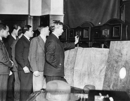 John Logie Baird watching a test transmission on his 30 line Model A 'televisor' television, 1931.