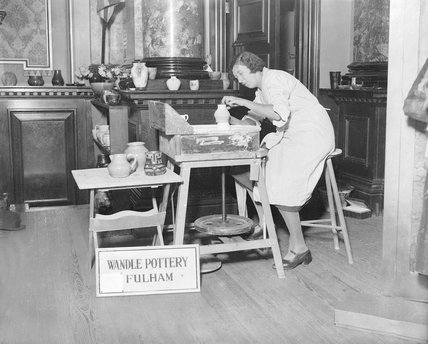 Miss Sybil Sandeman demonstrating the making of old English pottery at the Chelsea Arts and Crafts Exhibition at the Chelsea Town Hall, London. - 8-December-1931