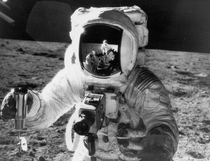 Astronaut Alan Bean with camera during Apollo 12 Lunar mission, November 1969.