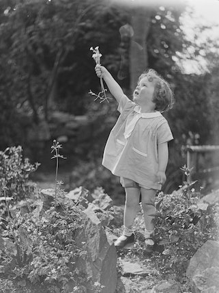 Young girl with a flower.