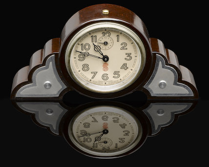 Dark brown, round-faced phenol formaldehyde (Bakelite) clock. France, 1930s.