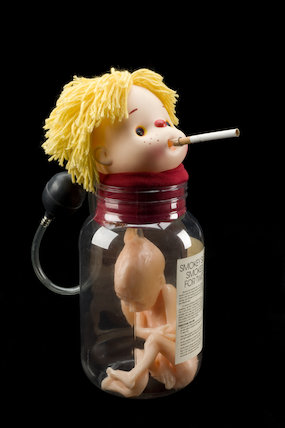 'Smokey Sue Smokes for Two'. Health education doll, by  Adam Rouilly Limited, 1995.