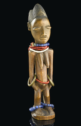 Ibedji figure representing a dead female twin. Nigeria, late 19th-20th century.