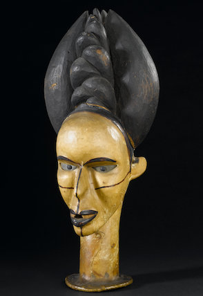 West African skin-covered fetish female head.