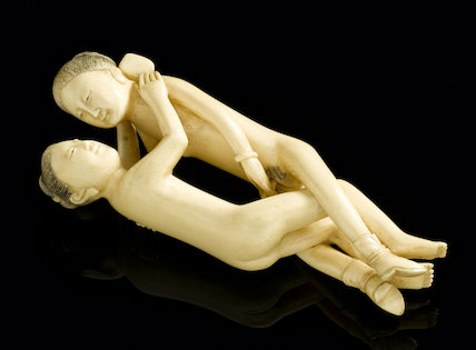 Statue in the form of a copulating man and woman, Far Eastern.