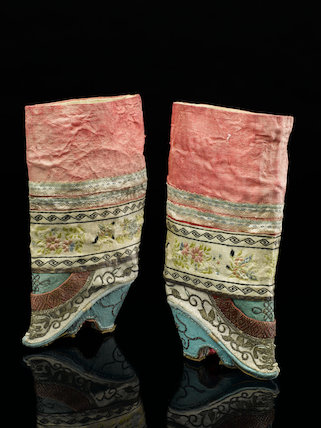 Pair of wooden soled shoes, China c.1910.