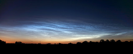 Photographs of noctilucent clouds appearing in the night sky over Britain on June 17, 2009.
