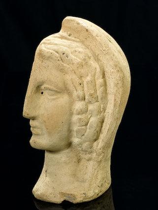 Left half of a a terracotta female head, Roman, 200 BCE-200 CE.