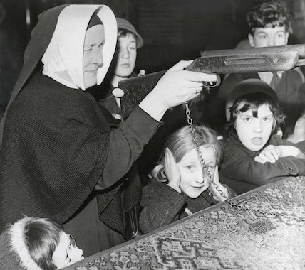 Sister Ignatious of St. Mary's Family Home trying out air riffle