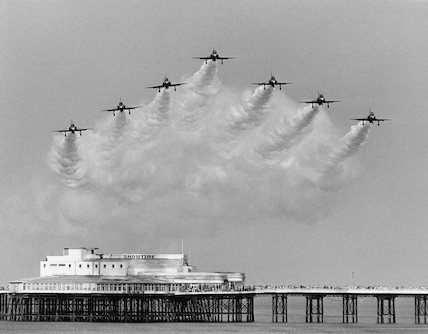Royal Air Force's Red Arrows flying in formation over Blackpool's North Pier.