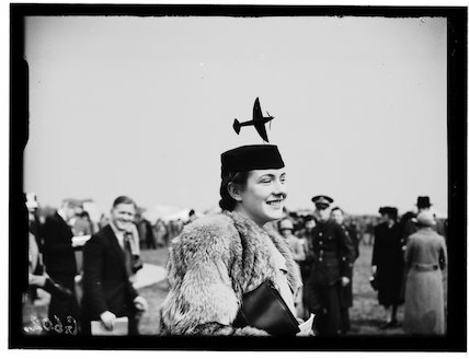 Woman wearing an aeroplane hat