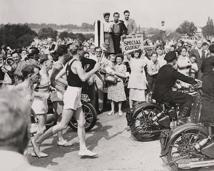 Olympic torch arrives at Wembley Stadium, London, 1948