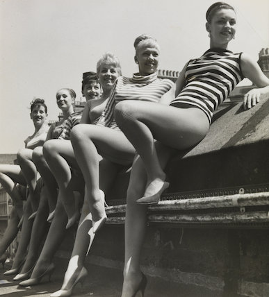 Dancing girls relaxing on the roof of London Palladium during rehearsals