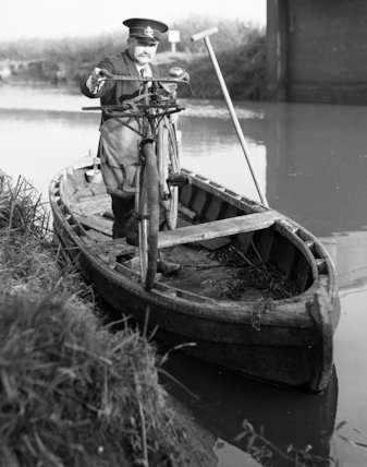 Wisbech - postman delivering by boat - 1937