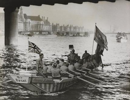 Oarsmen Bring Olympic Flag