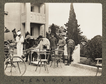 Russian snapshot album: group portrait on a terrace, c.1915