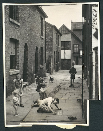 Children play in slum housing area in Hulme, Manchester, 1946