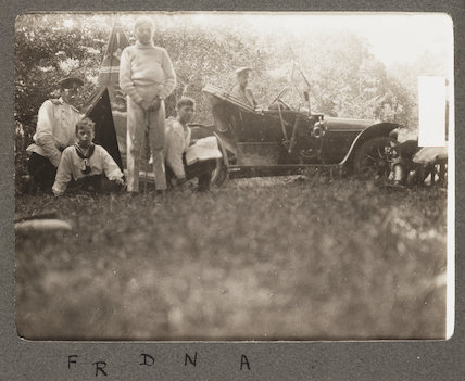 Russian royal family: group portrait with car, 1915