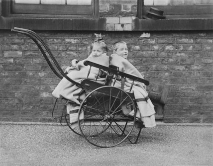 Two Young Children in a Two Seater Push Carriage at Crumpsall Workhouse, Manchester - c1890