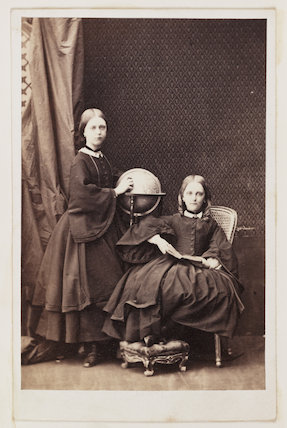 A carte-de-visite portrait of two young girls, probably sisters, taken by an unknown photographer in about 1865.