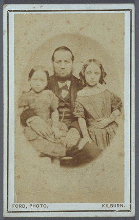 Carte-de-visite of father and two daughters