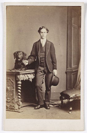 A carte-de-visite of a young man and a dog, taken by an unknown photographer in about 1875.