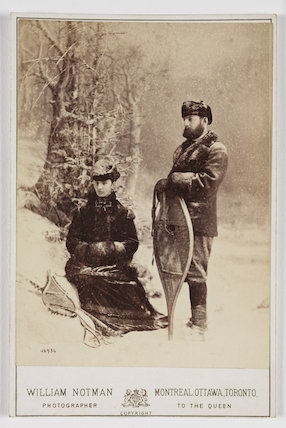 A carte-de-visite photogaph of a wintery scene featuring Captain Harris of the Royal Engineers and his wife, taken at a studio of William Notman (1826-1891) in about 1865.
