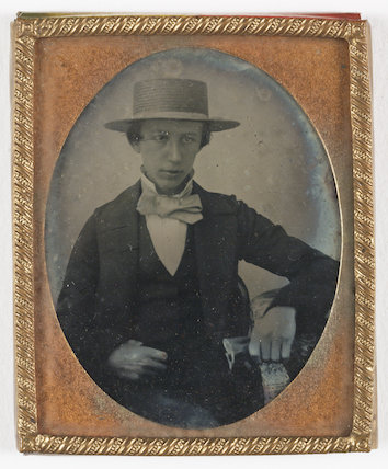 Boy wearing a straw hat, about 1858