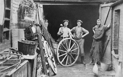 Blacksmiths Outside Their Smithy
