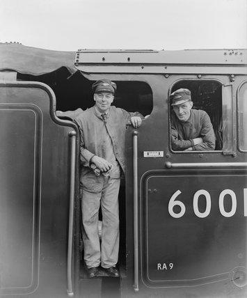Driver P E Heavens and fireman on a steam locomotive footplate, 1956.