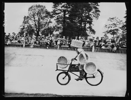 Basket-carrying cyclist at charity sports day
