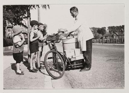 Icecream seller on bicycle, c 1925