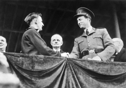 King Leopold congratulates British winner of International cross-country race before leaving for London - 22-March-1937