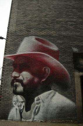 Mural of cowboy by El Mac in East London