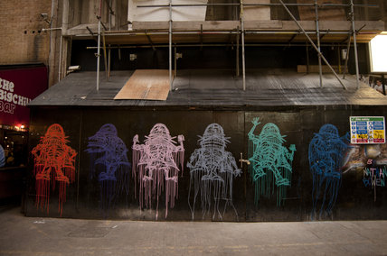Graffiti in East London of ghosts in Ely's Yard