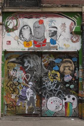 Graffiti collage on doorway in East London