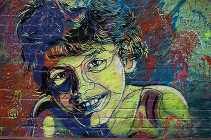Graffiti of boy by C215 in East London