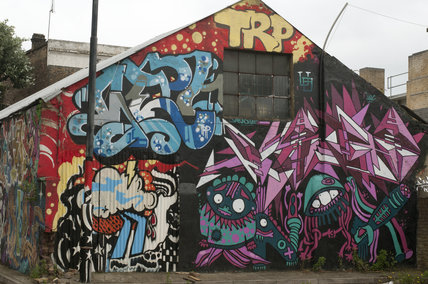Graffiti of collage on shed in East London