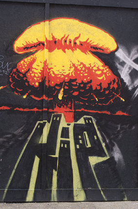 Graffiti of mushroom cloud over city scape in East London