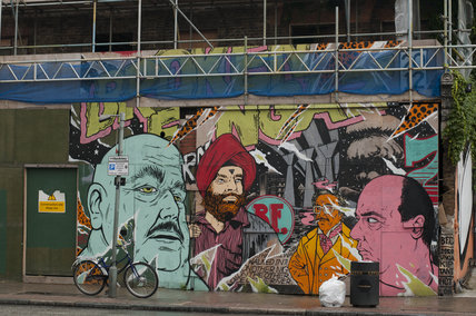 Graffiti collage in East London of abstract portraits