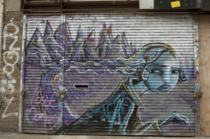Graffiti of girl and ghosts in East London
