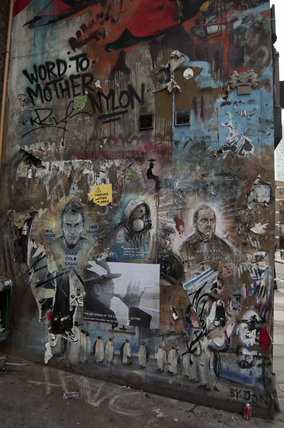 Graffiti portraits in East London on Hanbury Street
