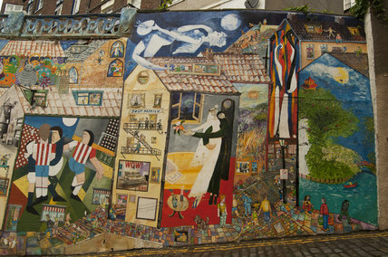 A collage of the Blands Cliff Murals on brick wall on Blands Cliff